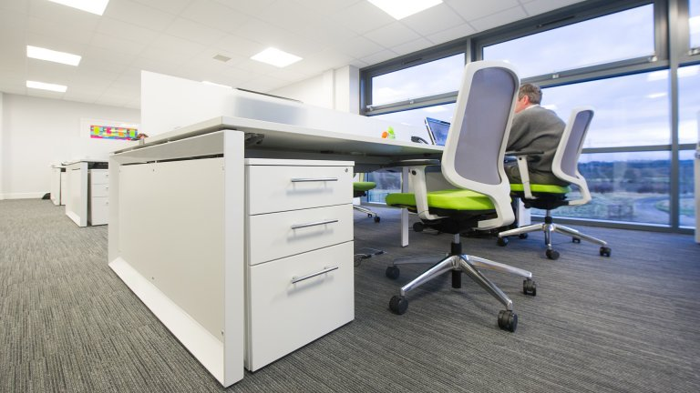 Close up of white office desks