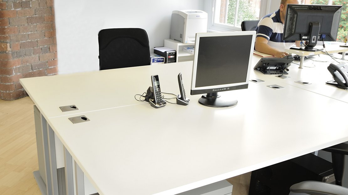 white desks in an office