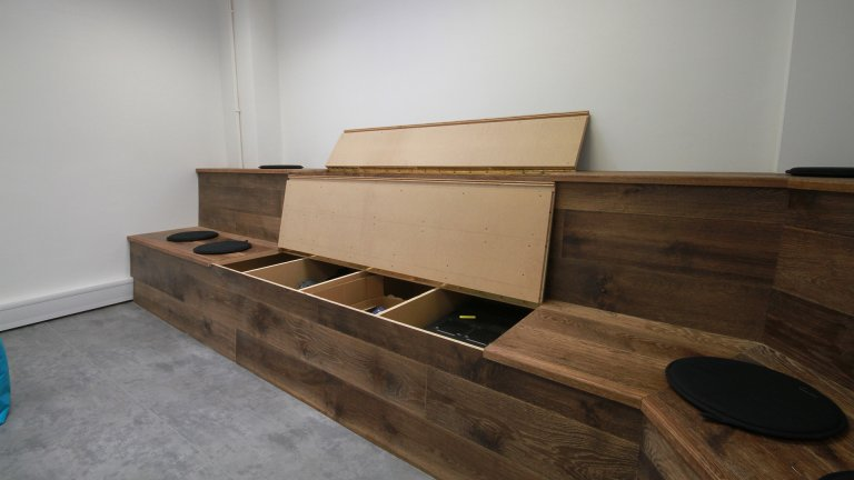 Bespoke storage area in ambitheatre seating