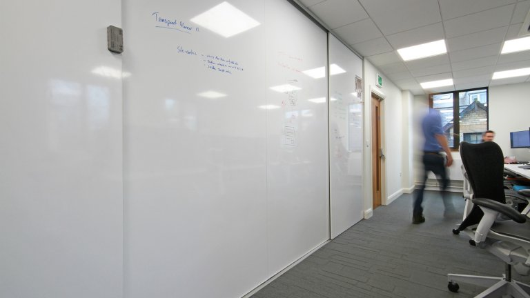 Whiteboard wall with sliding doors