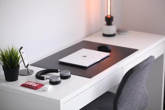 macbook on a desk